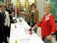 Jean Eng, Judy Makin and Brenda Jamieson register guests